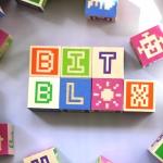 Pixel lettering embossed wooden blocks
